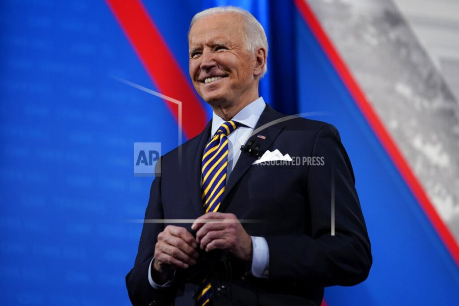 President Joe Biden stands on stage during a break in a televised town hall event at Pabst Theater, Tuesday, Feb. 16, 2021, in Milwaukee. (AP Photo/Evan Vucci)