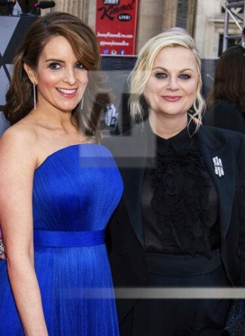 Hosts Amy Poehler and Tina Fey, Photo by Charles Sykes/Invision/AP