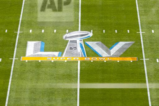 Detail view of Super Bowl LV logo on the field from an elevated position before Super Bowl 55 NFL football game against the Kansas City Chiefs and the Tampa Bay Buccaneers on Sunday, Feb. 7, 2021 in Tampa, Fla. (Ric Tapia via AP)