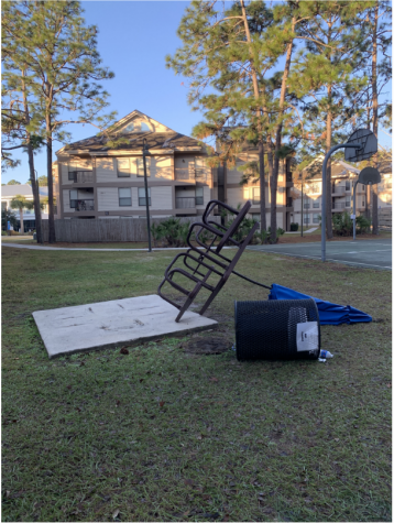 Photo of a knocked over picnic table / Photo courtesy of UPD