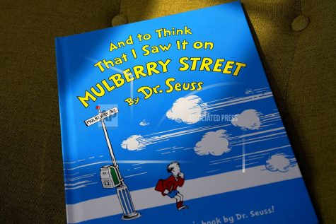 "A copy of the book ""And to Think That I Saw It on Mulberry Street,"" by Dr. Seuss, rests in a chair, Monday, March 1, 2021, in Walpole, Mass. Dr. Seuss Enterprises, the business that preserves and protects the author and illustrator"
