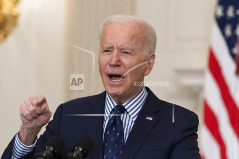 President Joe Biden speaks in the State Dining Room of the White House, Saturday, March 6, 2021, in Washington. (AP Photo/Alex Brandon)