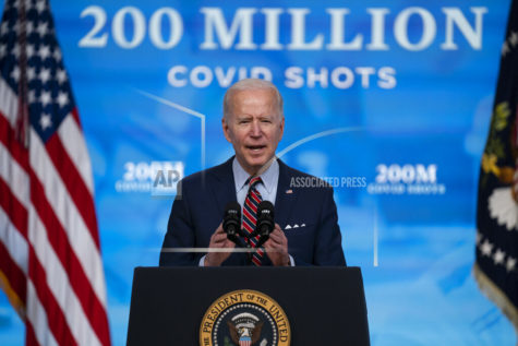 FILE - In this April 21, 2021, file photo, President Joe Biden speaks about COVID-19 vaccinations at the White House, in Washington. Biden spent his first 100 days encouraging Americans to mask up and stay home to slow the spread of COVID-19. His task for the next 100 will be to encourage the opposite behavior and manage the nation's transition back to normalcy. (AP Photo/Evan Vucci, File)