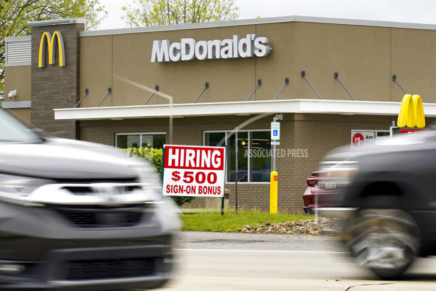 A hiring sign offers a $500 bonus outside a McDonalds restaurant, in Cranberry Township, Butler County, Pa., Wednesday, May 5, 2021.  U.S. employers posted a record number of available jobs in March, starkly illustrating the desperation of businesses to hire more people as the economy expands. Yet total job gains increased only modestly that month, according to a Labor Department report issued Tuesday, May 11. (AP Photo/Keith Srakocic)