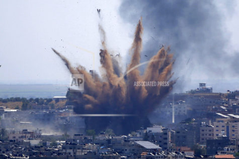 Smoke rises following Israeli airstrikes on a building in Gaza City, Thursday, May 13, 2021. Weary Palestinians are somberly marking the end of the Muslim holy month of Ramadan, as Hamas and Israel traded more rockets and airstrikes and Jewish-Arab violence raged across Israel. (AP Photo/Hatem Moussa)