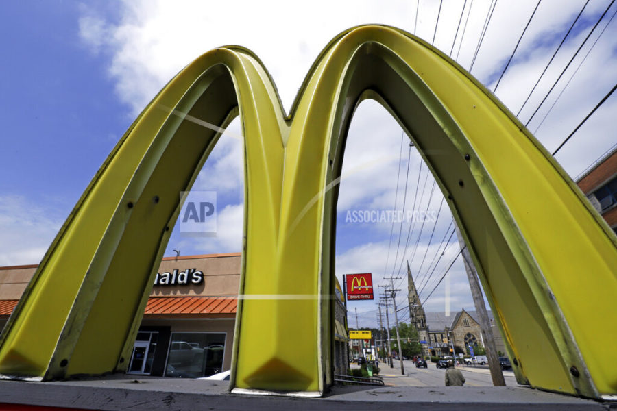 FILE - This April 30, 2019, file photo, shows a McDonald's restaurant on the Northside of Pittsburgh. U.S. restaurants and stores are rapidly raising pay in an urgent effort to attract more applicants and keep up with a flood of customers as the pandemic eases. McDonald's, Sheetz and Chipotle are just some of the latest companies to follow Amazon, Walmart and Costco in boosting wages, in some cases to $15 an hour or higher. (AP Photo/Gene J. Puskar, File)