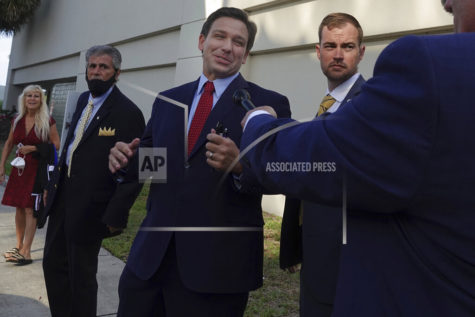 Florida Gov. Ron DeSantis leaves the site of an appearance, Thursday, May 6, 2021, in West Palm Beach, Fla.  DeSantis has signed a sweeping elections bill into law that he and other Republicans said would place guardrails against fraud, even though there were no signs of voter irregularities in the November presidential election.  (Joe Cavaretta/South Florida Sun-Sentinel via AP)