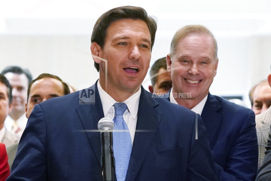 FILE - In this April 30, 2021, file photo surrounded by lawmakers, Florida Gov.Ron DeSantis speaks at the end of a legislative session at the Capitol in Tallahassee, Fla. Now that the pandemic appears to be waning and DeSantis is heading into his reelection campaign next year, he has emerged from the political uncertainty as one of the most prominent Republican governors and an early White House front-runner in 2024 among Donald Trump