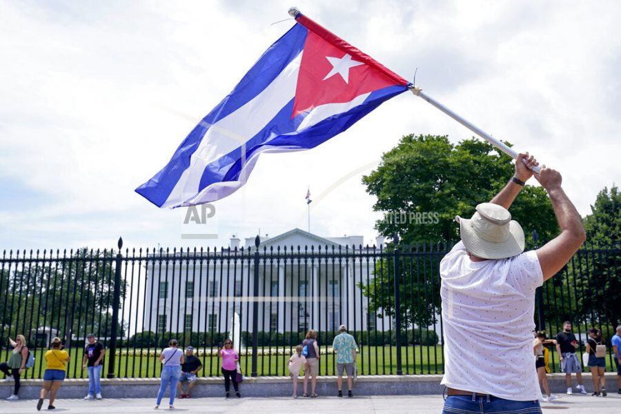 People participate in a rally outside the White House in Washington, Tuesday, July 13, 2021, in support of the protesters in Cuba. The problems of two tiny Caribbean states, Cuba and Haiti, have vexed U.S. presidents for decades. Now, Haiti and Cuba are posing a growing challenge for President Joe Biden that could have political ramifications.(AP Photo/Susan Walsh)