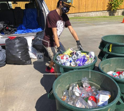 In this June 2021 photo provided by Maria Price,  Genshu Price drops off cans and bottles at a recycling center in Kahaluʻu, Hawaii. Price has recycled over 100,000 cans and bottles to raise money for students