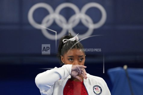 Simone Biles, of the United States, watches gymnasts perform at the 2020 Summer Olympics, Tuesday, July 27, 2021, in Tokyo. Biles says she wasn