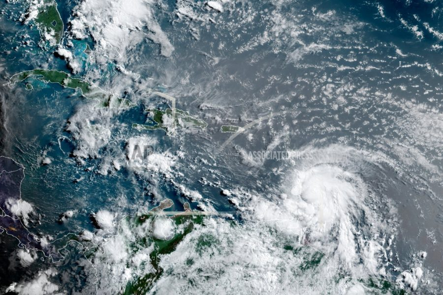 This+satellite+image+provided+by+the+National+Oceanic+and+Atmospheric+Administration+shows+Hurricane+Elsa+moving+through+the+Caribbean%2C+over+Barbados%2C+Tuesday%2C+July+2%2C+2021%2C+at+12%3A00+Z+%288am+a.m.+ET%29.+Elsa+was+expected+to+pass+near+the+southern+coast+of+Hispaniola+on+Saturday+and+to+move+near+Jamaica+and+portions+of+eastern+Cuba+on+Sunday.+%28NOAA%2FNESDIS%2FSTAR+GOES+via+AP%29