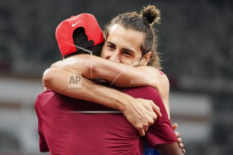 FILE - In this Aug. 1, 2021, file photo, Gianmarco Tamberi, of Italy, embraces fellow gold medalist Mutaz Barshim, of Qatar, after the final of the men