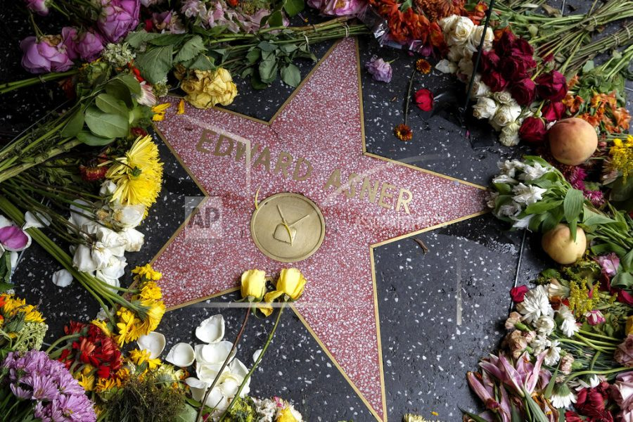 Flowers are placed at the star of late actor Edward Asner on the Hollywood Walk of Fame, Tuesday, Aug. 31, 2021, in Los Angeles. Edward Asner, who became a star in middle age as the gruff but lovable newsman Lou Grant in both the television comedy The Mary Tyler Moore Show and the drama Lou Grant, died on Sunday at 91. (Ringo Chiu via AP)