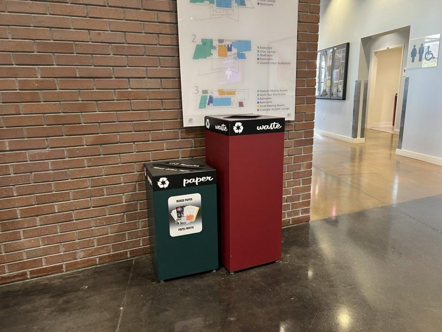 Waste and paper bins stand inside the Student Union.